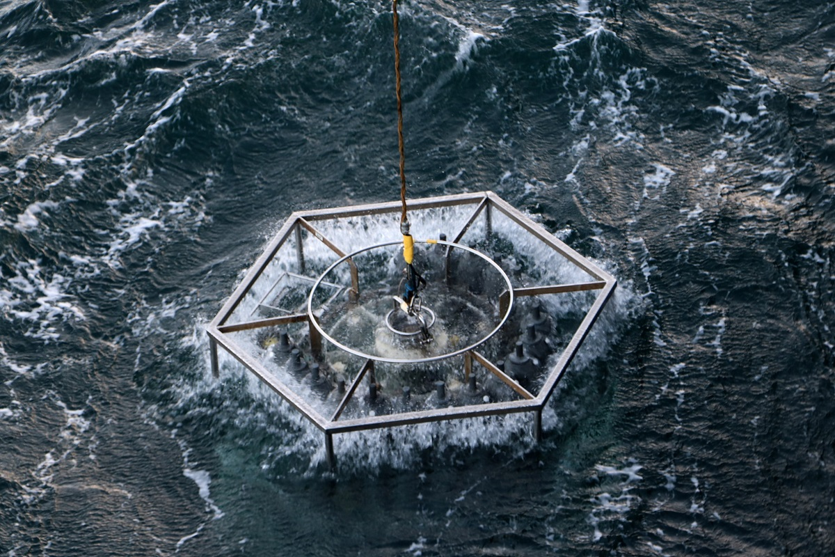 A CTD water sampler is pulled out of the frothing sea. Photo: NIOZ