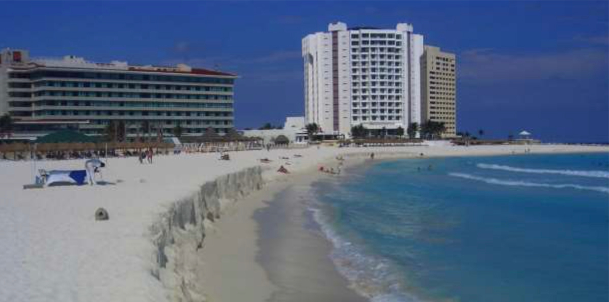 Regular sand nourishments are required on Cancun beach to maintain it, but start eroding immediately. Photo: Rodolfo Silva