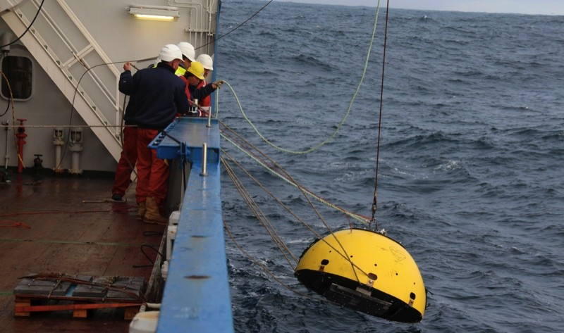 Deployment of a current profiler in a trawl-resistant frame.