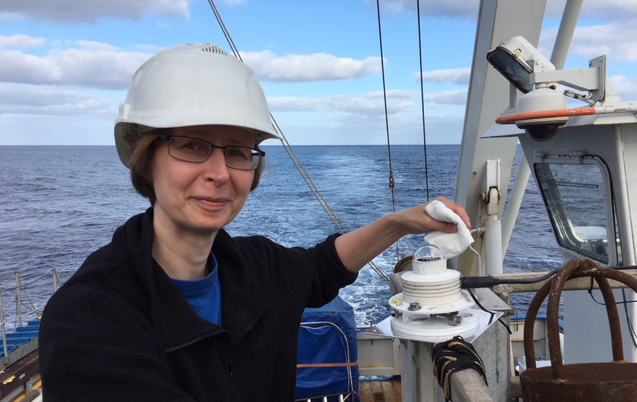 Dr. Anu Heikkilä measuring UV light intensity on board the R/V Pelagia.