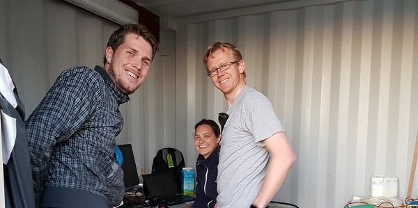 Johan, Karin, and Leo in the container on the aft deck where the side scan sonar data is recorded, getting ready for the evening's work
