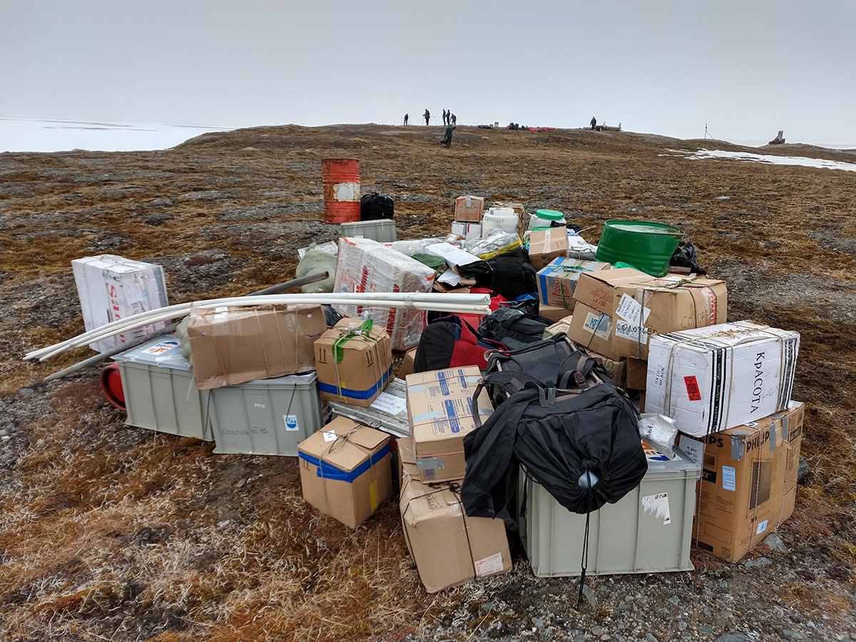 6 June 2019 Approximately 2,000 kg of luggage containing provisions and research material. In the background the team is pitching the tent camp.