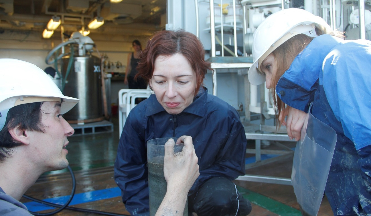 Rick, Laura and Darci are sampling from a sediment core.