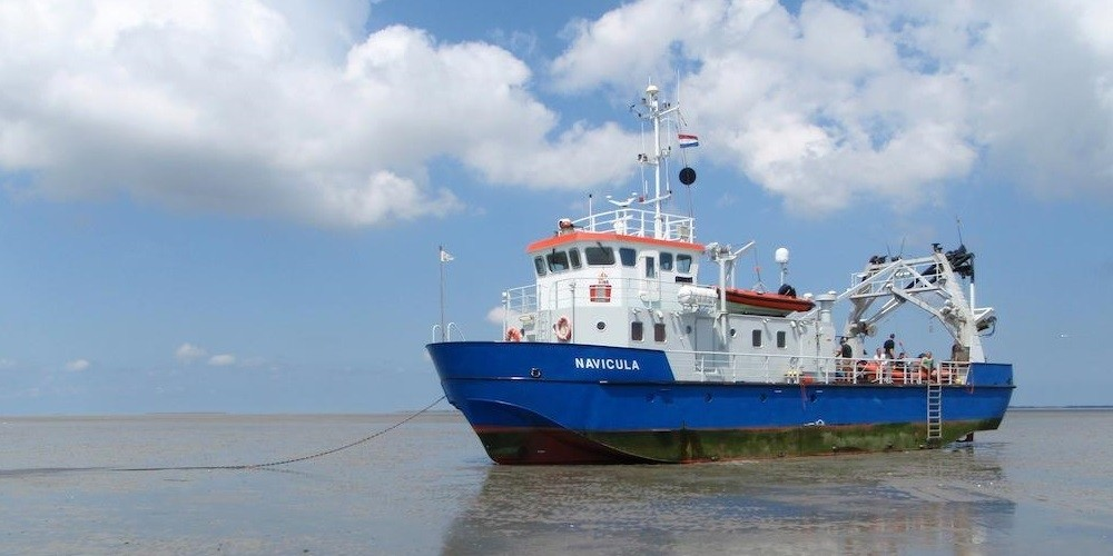 The RV Navicula during the SIBES project mission on the Wadden Sea.