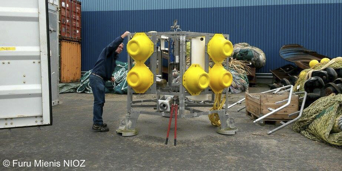 Preparing a lander for deep sea research on Porifera.