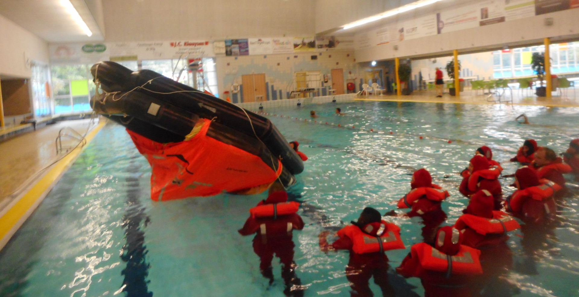 We get instructions on how to flip a life raft in the water