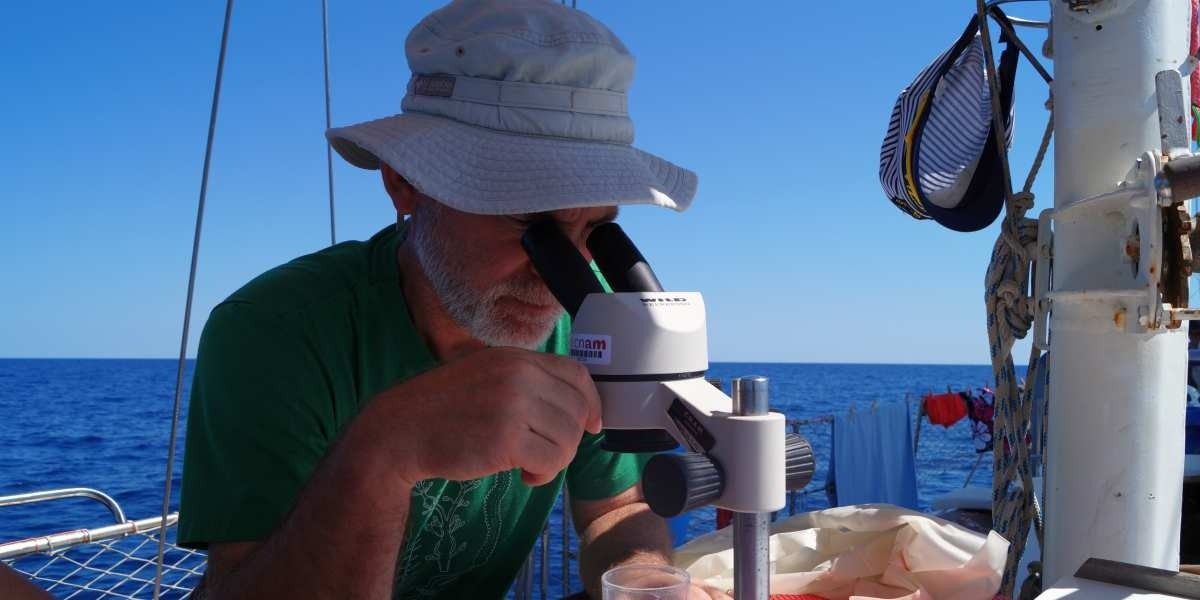 Erik checking plastic marine debris during summer 2017 ExpeditionMed cruise aboard sailing research vessel Ainez.