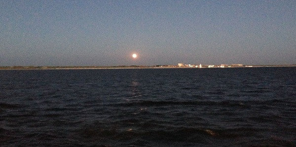 The moon rising over Egmond aan Zee, we were so close to the beach we could almost wave to the weekend beach goers