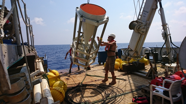The recovered sediment trap is hoisted on deck