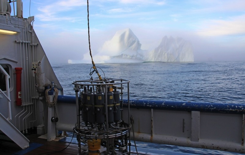 Iceberg on the Greenland shelf, with instrument package in front.