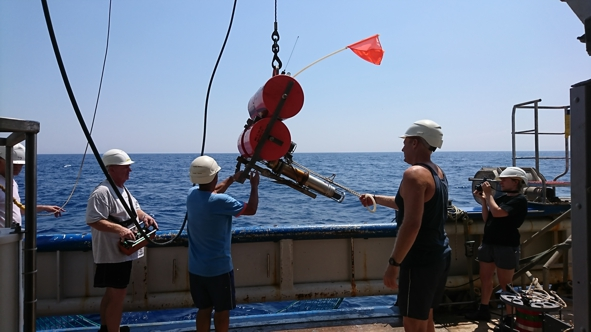 The released geodetic instrument is hoisted on deck