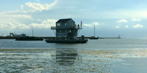 Wadtoren 'Richel' anchored on a mudflat in the Wadden Sea